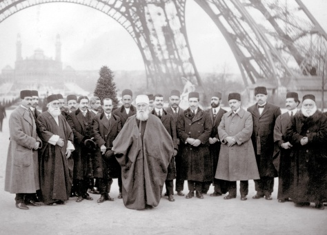 'Abdu'l-Bahá in Paris, photographed under the Eiffel Tower in 1912