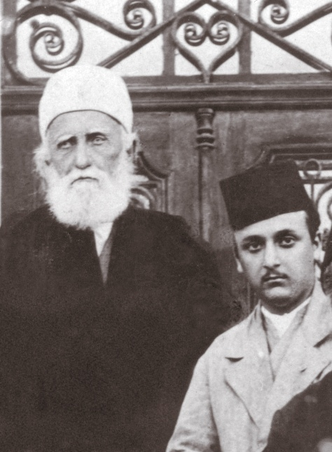 'Abdu'l-Bahá, left, and His grandson, Shoghi Effendi, in a photograph taken in 1919.