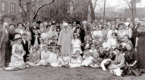 1912, 'Abdu'l-Bahá spent from April to December touring North America. He is shown here (at center) with Bahá'ís at Lincoln Park, Chicago, Illinois, USA, in 1912.